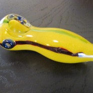 yellow glass smoking pipe