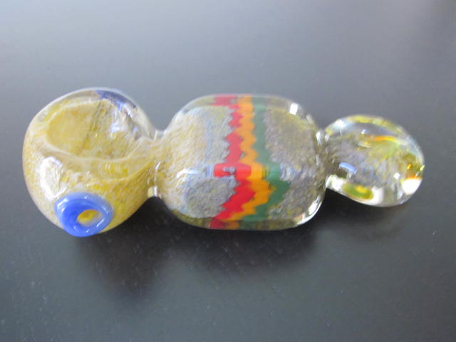Bob Marley style green handmade glass smoking pipe.